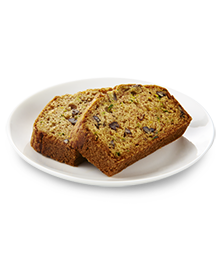 Two slices of zucchini bread on a small white plate