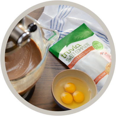 Truvia sweet complete bag laying next to a mixing bowl of ingredients