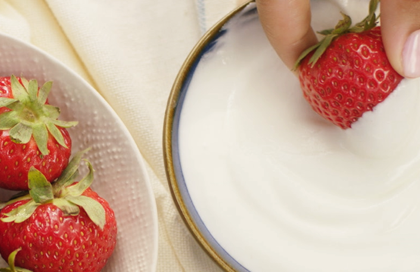 Dipping a strawberry in cream cheese fruit dip