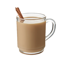 a glass mug of chai tea latte with a cinnamon stick