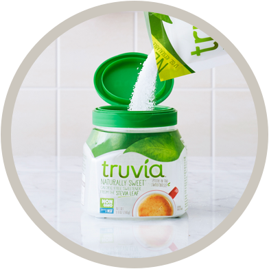 Truvia spoonable refill bag pouring into an empty spoonable container