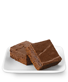 Two delicious fudgy brownies on a small white serving plate
