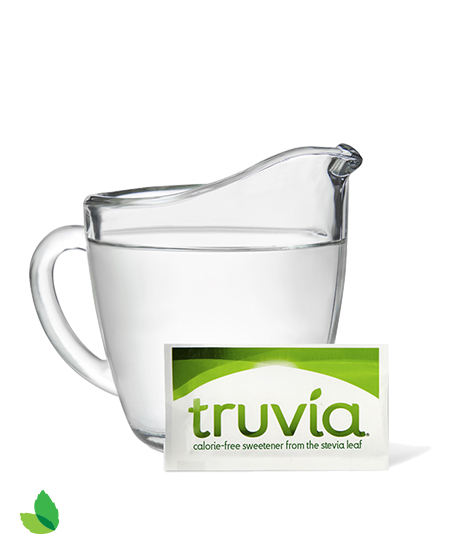 Glass pitcher of simple syrup and Truvia packet