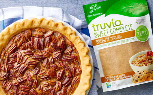 Pecan pie next to a bag of Truvia Sweet Complete Brown Sweetener
