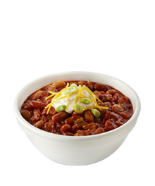 bowl of turkey chili with sour cream and cheese