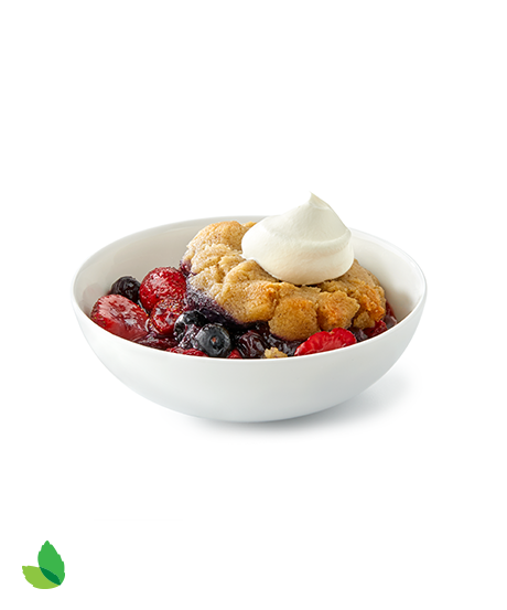 Bowl of berry skillet cobbler