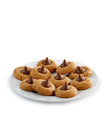 Plate full of almond thumbprint cookies with chocolate kisses