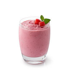 Glass of raspberry frozen yogurt