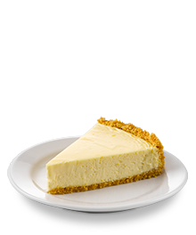 Slice of classic cheesecake on a white serving dish