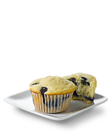 Two blueberry muffins on a white square serving dish